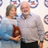 Swim school association honors local couple