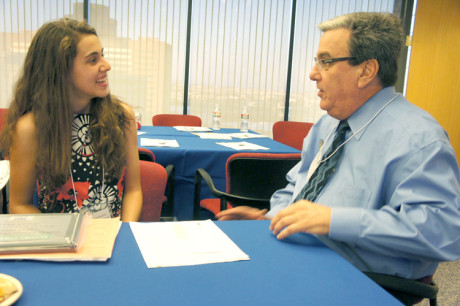 "North Central youth Bailey Lockwood is congratulated on her winning essay by Bill Straus, Anti-Defamation League regional director. Straus complimented her use of compelling language and chatted about the fact that they are both ""graduates"" from Madison Meadows (photo by Teri Carnicell)."