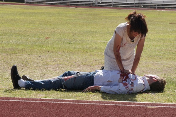 Central High drama student Itzel Velasco performs CPR on fellow student Richard Jenkins during a mock DUI crash demonstration.