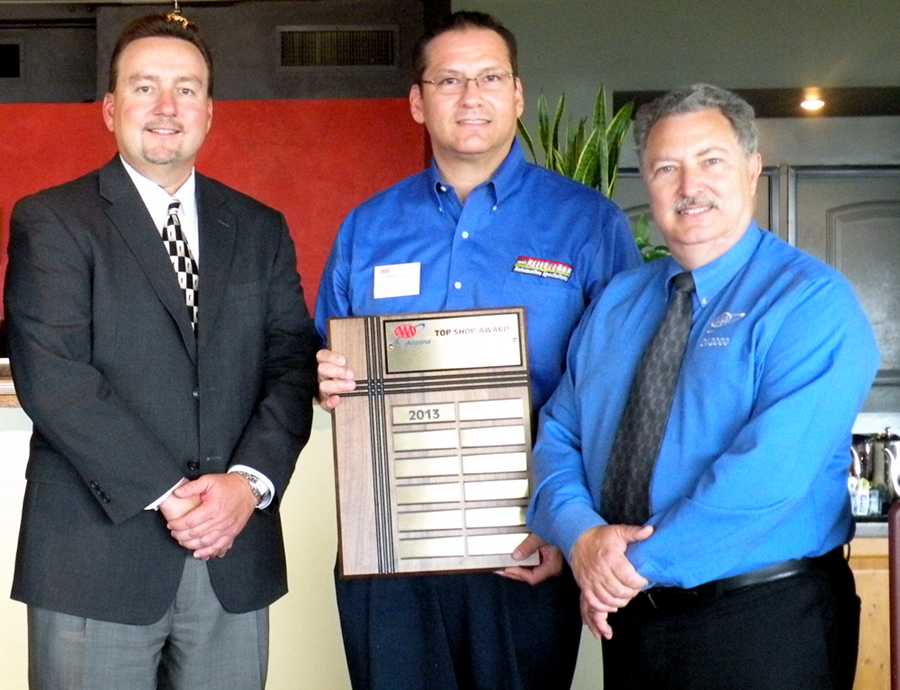 Jesse Garcia (center), from Kelly Clark Automotive Specialists at 12th Street and Glendale Avenue, accepts the AAA 2013 Top Shop plaque from John Walter, left, and Don Nunnari, right, of AAA Arizona (photo courtesy of AAA Arizona).