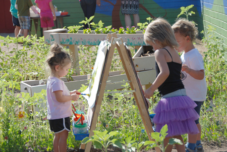 "Children enjoy painting—and some beautiful spring weather—as part of Beth El Center for Early Childhood Education's ""Nature Explore Classroom"" (photo courtesy of Beth El Center for Early Childhood Education)."