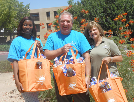 "Getting ready to head out into the community with their ""cool"" gifts are, from left: Nina Louis, Skilled Nursing Facility administrator; John Wenzlau, executive director; and Donna Anderson, Community Relations director, of Emeritus Senior Living's Chris Ridge facility (submitted photo)."