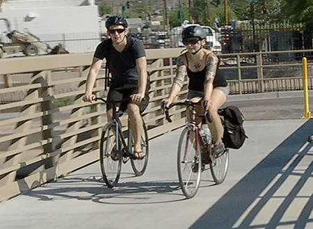 The timing could hardly have been better as the city of Phoenix officially opened a new pedestrian and bicycling bridge crossing the Arizona Canal at 15th Avenue north of Dunlap Avenue, just in time for bike riders and walkers to enjoy the cooler mornings and evenings (photo courtesy of Skyline Productions).