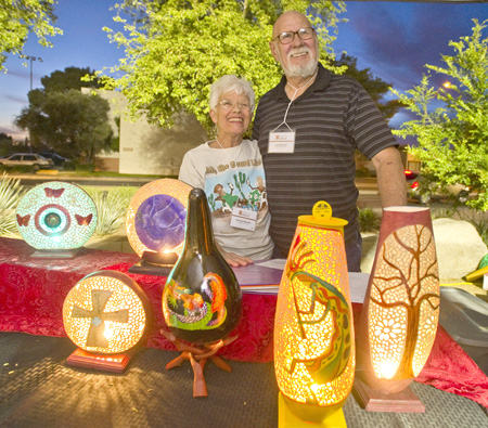 Carolyn and Lyle Mitchell show off their unique Chrysalis God Gourds at the spring 2013 Sunnyslope Art Walk (submitted photo).