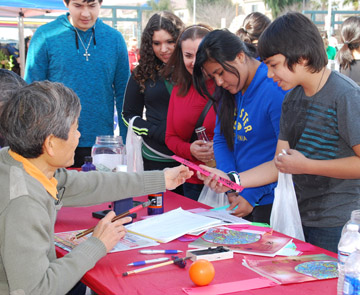 Phoenix teens learn more about calligraphy, a type of visual art related to writing and popular in ancient Chinese cultures, during the annual Chinese Week Culture & Cuisine Festival, which takes place Feb. 7-9 at a new location, Margaret T. Hance Park (submitted photo).