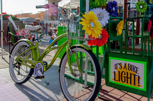 Did you know that if you ride your bicycle after sunset, Arizona law requires you to have a front light? That doesn't mean it has to be a boring one. Lynn Teitel of Pedal Brite in Scottsdale sales flower bike lights that add some style to your cruiser's bike basket. She will be at the Sunnyslope Art Walk at Central and Dunlap avenues on Saturday, April 12 (submitted photo).