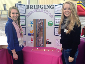 Hannah Toledo, left, and Kate Randolph of Xavier College Preparatory display the Color Canalscape project they created as part of The Bridge Team (submitted photo).