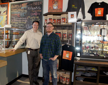 Steve Capobres, left, vice president of Business Development for Catholic Charities, and John Strawn, manager of The Refuge, are proud of the social service-oriented eatery that sells its own locally roasted coffee, fresh-baked pastries, and craft items created by refugees living in Phoenix (photo by Teri Carnicelli).