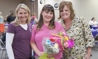 Crystal Thomas, center, is congratulated on her recent graduation from The Bridge to Hope by B2H Director AmySue Seiser, left, and B2H case manager Sallie Jarboe, right (photo by Teri Carnicelli).
