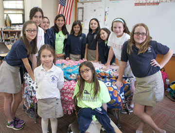 Members of the St. Francis Xavier Blanket Club include, clockwise, from bottom left:  Hadley Oviatt, Breannah Smiley, Sophia Alameddin, Lauren Pierce, Juliana Ramirez, Leina Rascon, Annabel Rodriguez, Chloe Pradhan, Nataly Oviatt, Lyndee Sundberg, and Cate Pradhan (photo by Teri Carnicelli).