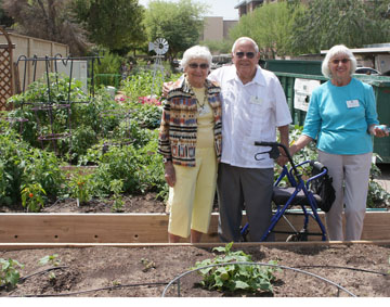 Showing off the impressive vegetable garden beds at the Beatitudes Campus are Garden Club volunteer Lou Hanson, Garden Club founder Lowell Bailey, and his wife and club volunteer Joannie Bailey, who he met—and married—after moving to the campus (photo by Teri Carnicelli).