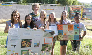 Celebrating their Silver Awards for their Monarch Butterfly awareness and education project are members of Girl Scout Troop 1629, from left: Caleigh Border, Penny Spivey, Troop Leader Lori Terauds, Kaija Terauds, Zoe Wilson, Brenna Slawson, and Kelsi Kitagawa (photo by Teri Carnicelli).