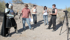 "Preparing to shoot a fight scene from Voyage Trekkers Season 2, Episode 2, ""Laser Swords at Dawn,"" are, from left: Craig Curtis as General Kang; writer/director Nathan Blackwell; second assistant–camera Noel Lucas; line producer Stephanie Mello, and Adam Rini as Captain Jack Sunstrike (photo courtesy of Voyage Trekkers)."