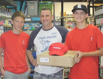 "Madison Meadows NJHS students Lance Keeble and Quinn Funke receive a donation from John Koller, a partner with Barry's True Value Hardware, to help with their ""Semester of Service"" project to repaint the exterior of the ICM Food & Clothing Bank in downtown Phoenix (submitted photo)."