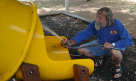 Tom Franklin, co-founder of the successful Franklin Phonetic School in Prescott Valley, cleans off a slide in the play area at his new school campus, located on the grounds of Sunnyslope Presbyterian Church. The new school is slated to open on Aug. 18 (submitted photo).