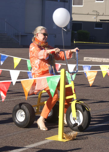 Linda Herold, a Phoenix philanthropist and longtime supporter of Florence Crittenton, prepares to set off on a high-heeled tricycle race in the Diva Dash, part of Florence Crittenton's annual Heels for Healing benefit shopping event (submitted photo).