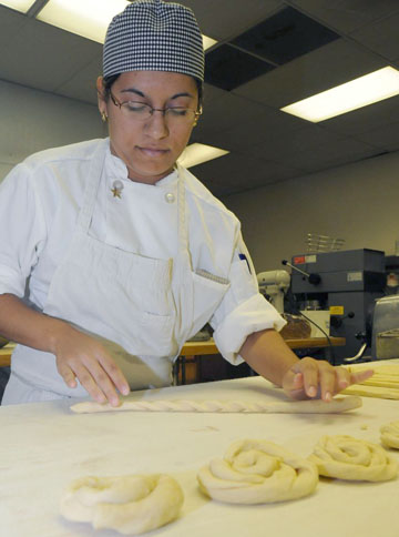 Gina Ostos, who graduated last year from Metro Tech High School, participated in the school's culinary arts program, where she learned how to bake from scratch, among other skills (submitted photo).