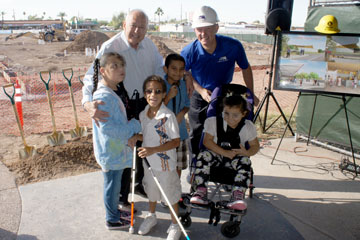 Don Tapia, left, a longtime supporter of the Foundation for Blind Children, and the nonprofit's CEO Marc Ashton celebrate the campus's $10 million expansion with some of the children who attend FBC (photo by Teri Carnicelli).