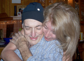 Terry Ratner gives a hug to her husband, Michael, just two weeks before he passed away from esophageal cancer (photo courtesy of Terry Ratner).