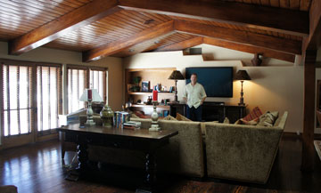 North Central realty expert Bobby Lieb of HomeSmart Elite Group stands inside the family room of the former McCain home on Central Avenue, currently for sale for $2.5 million. The home features original wide-plank floors throughout as well as original wood beams (photo by Teri Carnicelli).
