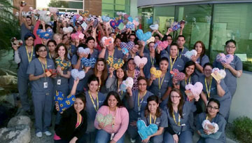 As part of the Carrington Cares community outreach program, students in the Medical Assisting program at Carrington College's Phoenix North recently cut, stuffed and sewed heart-shaped pillows that they later delivered to little patients at Phoenix Children's Hospital (submitted photo).