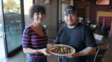 Michelle McGee, co-owner of Wild Game Grill, and Chef Victor Cabrera show off on of the niche eatery's Thursday specials: Muscovy duck breast with cauliflower puree, grilled vegetables and lightly seasoned lentils (photo by Teri Carnicelli).