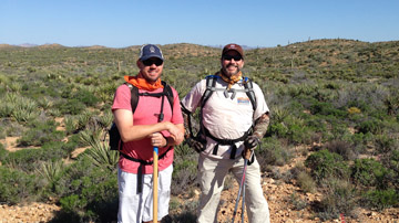 Tom Davis, right, vice president of Pioneer Title Agency's Phoenix Peak office, takes a break with fellow hiker Brian Eves of Barger Moulding, on Passage 15 of the Arizona Trail (photo courtesy of Tom Davis).