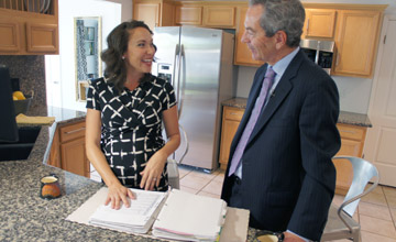 Jenny Clark, whose active family of five—with one more on the way—has accumulated numerous medical records, explains to HonorHealth CEO Tom Sadvary how she used to take a large binder with all the family's records to all doctor appointments. With HonorHealth's interconnected network of care, all their medical records are easily accessed electronically by any doctor, hospital or urgent care in the network (photo by Teri Carnicelli).