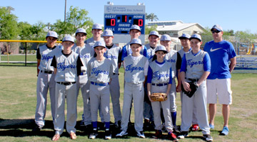 Coach Mark Wagner and the All Saints' Episcopal Day School baseball team take to their brand-new regulation field, complete with digital scoreboard, on March 10 for their home opener game (submitted photo).