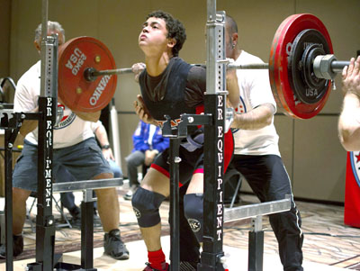 North Central teen Evan Pittman performs a world-record squat of 336 pounds in the 148-pound weight class, teenage division, during the U.S. Powerlifting Federation national championships in Las Vegas on May 2 (photo by Scott Pittman).