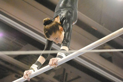North Central youth Gracie Reeves competes on the high bar at the 2015 Classic Rock Invitational, held in Phoenix. She took first place in the All Around (photo by Lauren Stevens).