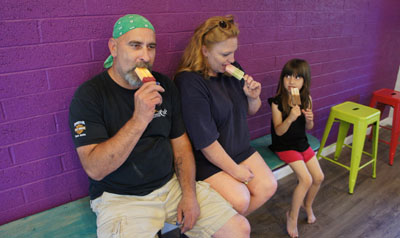 Cooling off with an afternoon treat at the new AZ Pops are Doug and Kathi Boggess of Waterwise Irrigation, with their granddaughter, Melissa, 4. Doug is enjoying a mango black cherry, Kathi is trying the cucumber watermelon and Melissa knew exactly what she wanted—chocolate coconut (photo by Teri Carnicelli).