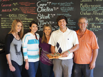 Though their new restaurant may be named after youngest child, George, every member of the Deligiannis family can be found working at George's Kitchen including, from left: Stacey, Angela, Ellen, George and Jim (photo by Teri Carnicelli).