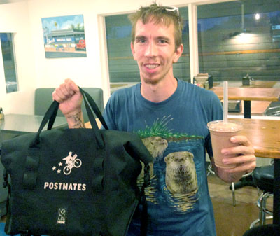 Paul Jones delivers a burger and shake from The Stand to a hungry customer. The Postmates bag keeps hot food hot and cold food cold (submitted photo).