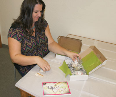 Heidi Koffman, co-founder of The Hippy Hobby, assembles one of the DIY craft boxes available for purchase on the website, which includes free shipping. This particular box allows you to make homemade lip balm and includes shea butter, sunflower seed oil, essential oils and beeswax (photo by Teri Carnicelli).