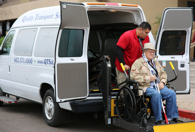 Matt Matthews, a driver with QTS, assists Donald Hansen with getting to his doctor's appointment courtesy of the free Veterans Transportation Assistance Program (photo courtesy of Quality Transport Services of Arizona).
