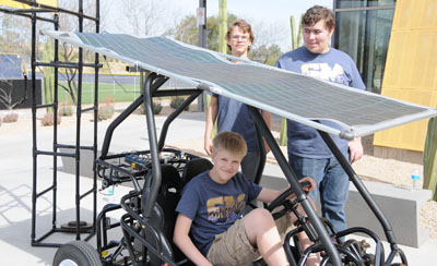 Students from Shadow Mountain High School in north Phoenix show off their solar-powered go-cart. The school's GenYES program is internationally recognized in tech leadership, innovation, coding projects, micro processing, web applications and computer hardware. SMHS GenYES students regularly provide workshops and present their tech expertise at national events (submitted photo).