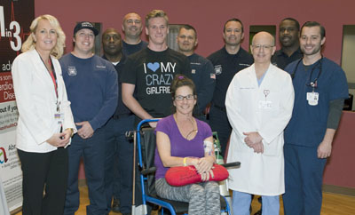 Abrazo Arizona Heart Hospital patient Michelle Dean and her son, Alex (behind her), gave a grateful thank you to the Phoenix firefighters from Station 17 who saved her life and kept her heart beating after she collapsed outside of work on Jan. 25 (photo courtesy of Abrazo Community Health Network).