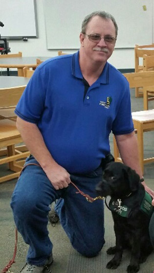 Phoenix resident Brad Stocking has been a guide dog puppy raiser for five years and currently is training his seventh dog, a 5-month-old black lab named Uni (submitted photo).