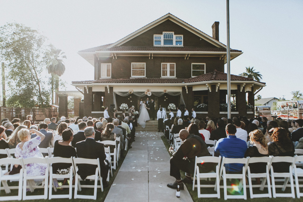 Amy Ellis Shackelford says her wedding vows to husband-to-be, Aaron Aguirre, on the porch of the home built by her great-great grandfather, William C. Ellis, in downtown Phoenix (photo by Jay & Jess Photography).
