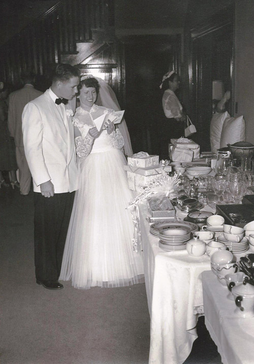 Ellis and Sally Shackelford browse through their wedding gifts and cards on the day of their marriage, Aug. 15, 1953, at the Ellis-Shackelford Home in downtown Phoenix (photo courtesy of the Shackelford family).
