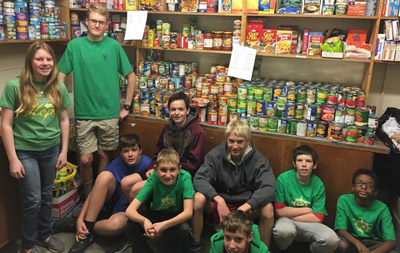 Boy Scout Troop 329 Scouts and family members who worked to load and sort food to replenish the shelves of the Church of the Beatitudes Bishop's Pantry are, from left: Jennifer Brown, Ryan Brown, Alex Dawson, Bennett Buisker, Charlie Talbot, Spencer Cook, John Hubert, Bobby Hubert, and Jay Hurd (submitted photo).
