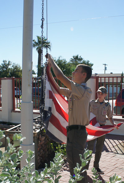 Brothers Jack Moody, left, and Will Moody, both Eagle Scouts with Boy Scouts Troop 6, raise the American flag during the dedication ceremony for the Blanche Duggan Memorial Garden at Loma Linda Elementary (photo by Teri Carnicelli).