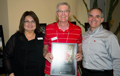 From left: Lillian Garcia, Red Cross Regional Volunteer Services officer for the Arizona-New Mexico-El Paso Region; Michael Young, Red Cross Rookie of the Year; and David Emerson, Red Cross CEO for Arizona-New Mexico-El Paso Region (photo by Todd Tamcsin).