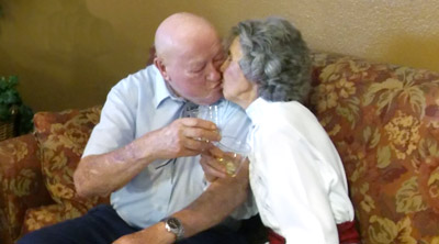 The flame is still burning for Dean and Mary Jones, who celebrate their 70th wedding anniversary with a toast and a kiss (submitted photo).