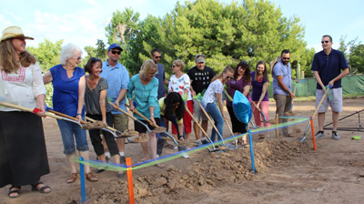 Margo S. O'Neill, Head of School at Villa Montessori School (fifth from left) is joined by members of the staff and school community in breaking ground on the school's $5.8 million expansion (photo by Elizabeth Van Wie).