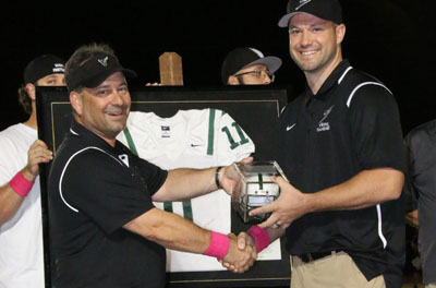 Kevin Hanson, left, president of the Vikings Booster Club, presents former Sunnyslope High School football player Mike Nixon with a commemorative helmet during a special ceremony on Oct. 7 where Nixon's No. 11 jersey was officially retired (photo courtesy of Sunnyslope Football).