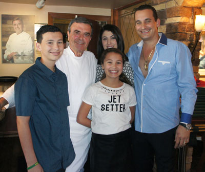 """Phoenix Mayor Greg Stanton declared Sept. 29 to be """"Tomaso's Day,"""" in honor of restaurateur and chef Tomaso Maggiore, whose family came to celebrate the special day with him. Clockwise from left are: grandson Tomaso Maggiore, and his namesake; daughter-in-law Christina Maggiore, son Joey, and granddaughter Melina Maggiore (photo by Teri Carnicelli)."""
