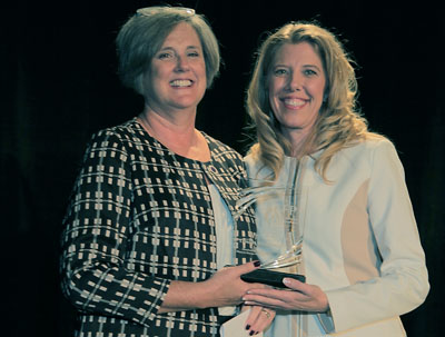 Catholic Charities' Tamara Bohannon, left, accepts her Outstanding Fundraising Executive Award from Torrie Taj, the president of the Arizona chapter for the Association of Fundraising Professionals (photo by Ben Arnold).