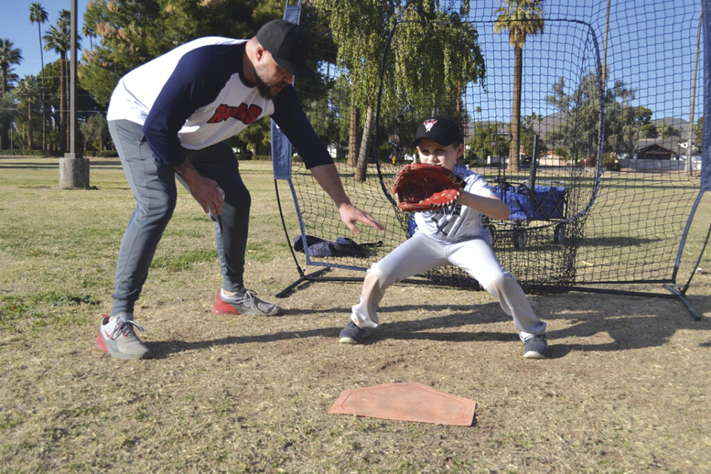 Corey Loyd, director of baseball for Recreation Association of Madison Meadows & Simis (RAMMS) helps his son, Maddox, 9, practice ahead of the RAMMS' baseball season, which is scheduled to start March 13 (photo by Colleen Sparks).